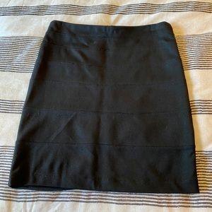 Black zip back mini skirt